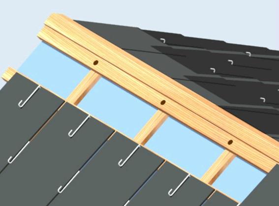 Colocar la cumbrera solapada a la última capa de pizarras